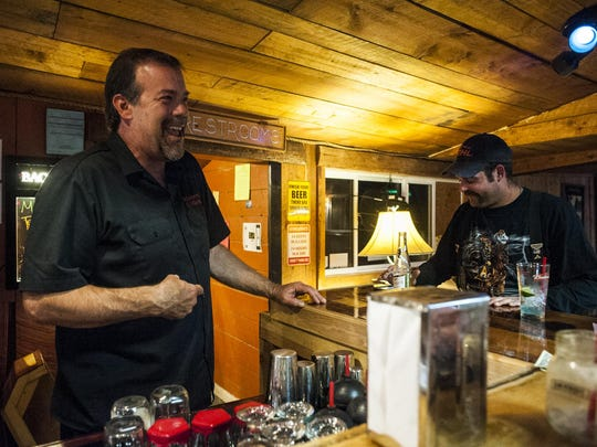 "John Runkle laughs with a customer at the Dirty Shame Saloon. Runkle has turned down many offers from reality television shows over the years. ""I have no shortage of wacky customers but none of them would go on TV,"" he said."
