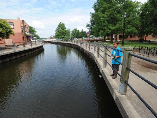 Nichalos Hall, 8, of Milford cast his fishing line in the Mispillion River in downtown Milford.