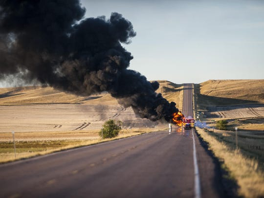 An overturned tanker truck continues to burn near mile marker nine north of Great Falls Saturday evening.