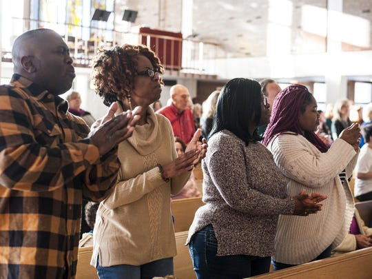 Left, Kelvin and Cheryl Steele stand and clap to the music during the Martin Luther King, Jr. Day celebration in the University of Great Falls' Trinitas Chapel Monday.
