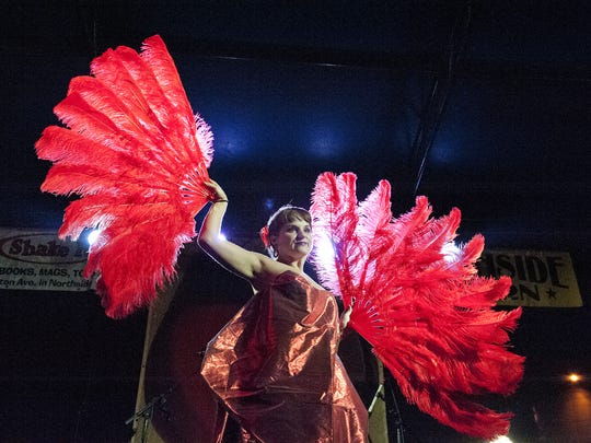 A fan dancer from Cin City Burlesque performs her act.