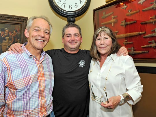 (From left:) Martin, Dan and Marilyn Wade at Grammer's in 2011.