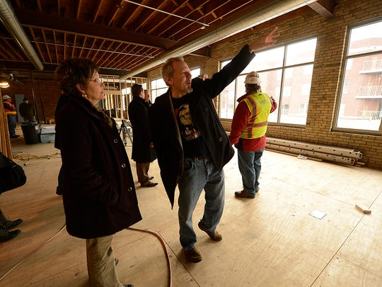 District 7 Alderman Randy Scannell visits with Julie Lamine, Meyer Theatre director, while taking a tour Wednesday inside the office space for Breakthrough Fuel at the Meyer Theatre in downtown Green Bay.