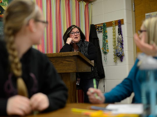 In middle, Paula Abbott talks to her students inside a fundamentals of public address class at Denmark High School on Thursday, March 26, 2015. The class is a dual college credit course.