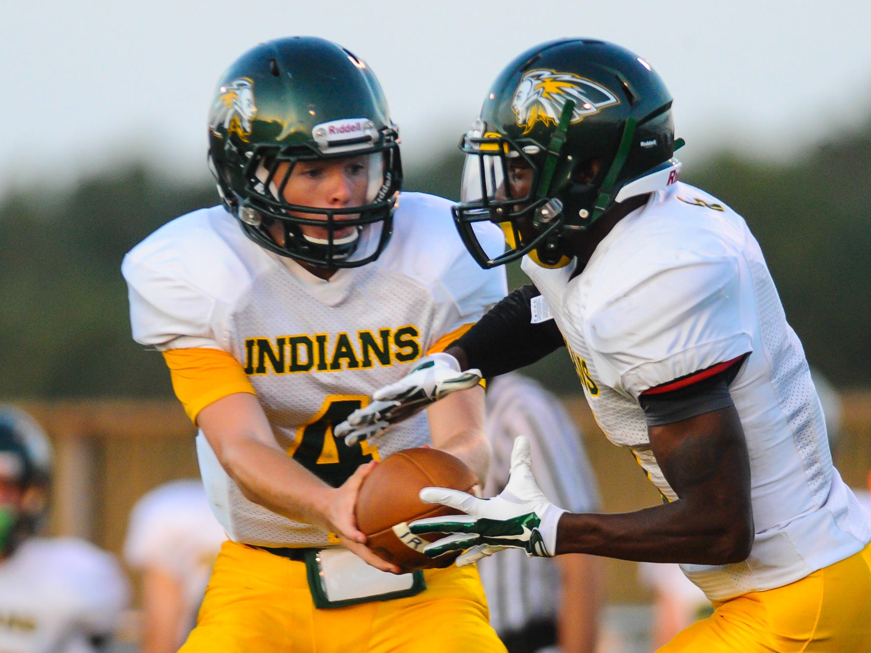 Indian River quarterback Jacob Hudson hands off to running back KiAnte Sturgis against Stephen Decatur on Friday night in Berlin.