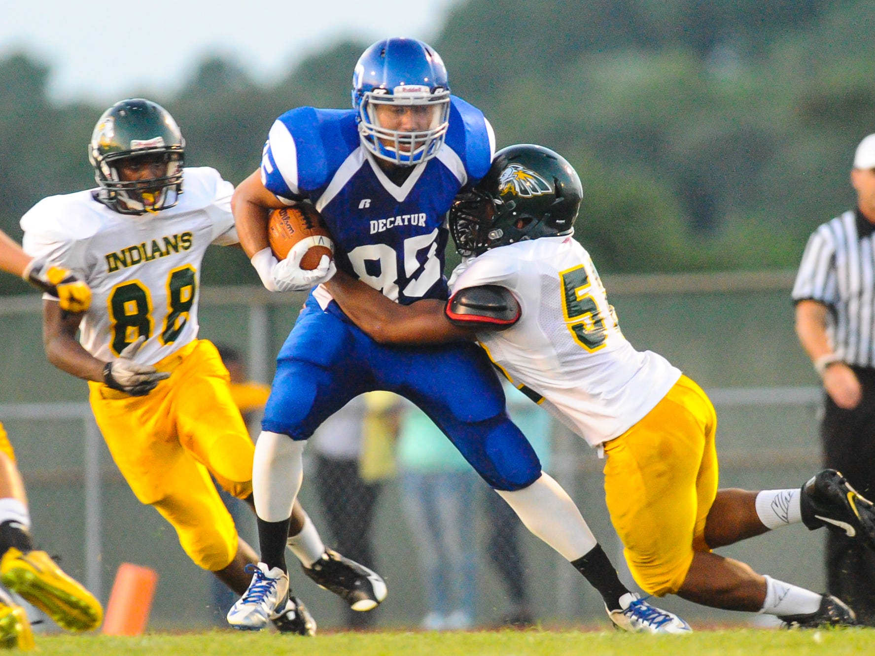 Stephen Decatur wide reciever Matt LeCompte is wrapped up by Indian River linebacker Lance Harmon in Berlin.