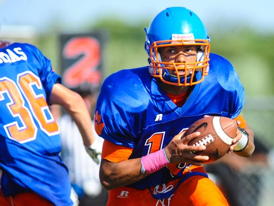 Delmar quarterback Shane Leatherbury takes off on the keeper against Milford at Delmar High School on Saturday afternoon. Leatherbury had two rushing touchdowns and a passing touchdown in the Wildcats 33-6 win over Mt. Pleasant on Saturday.