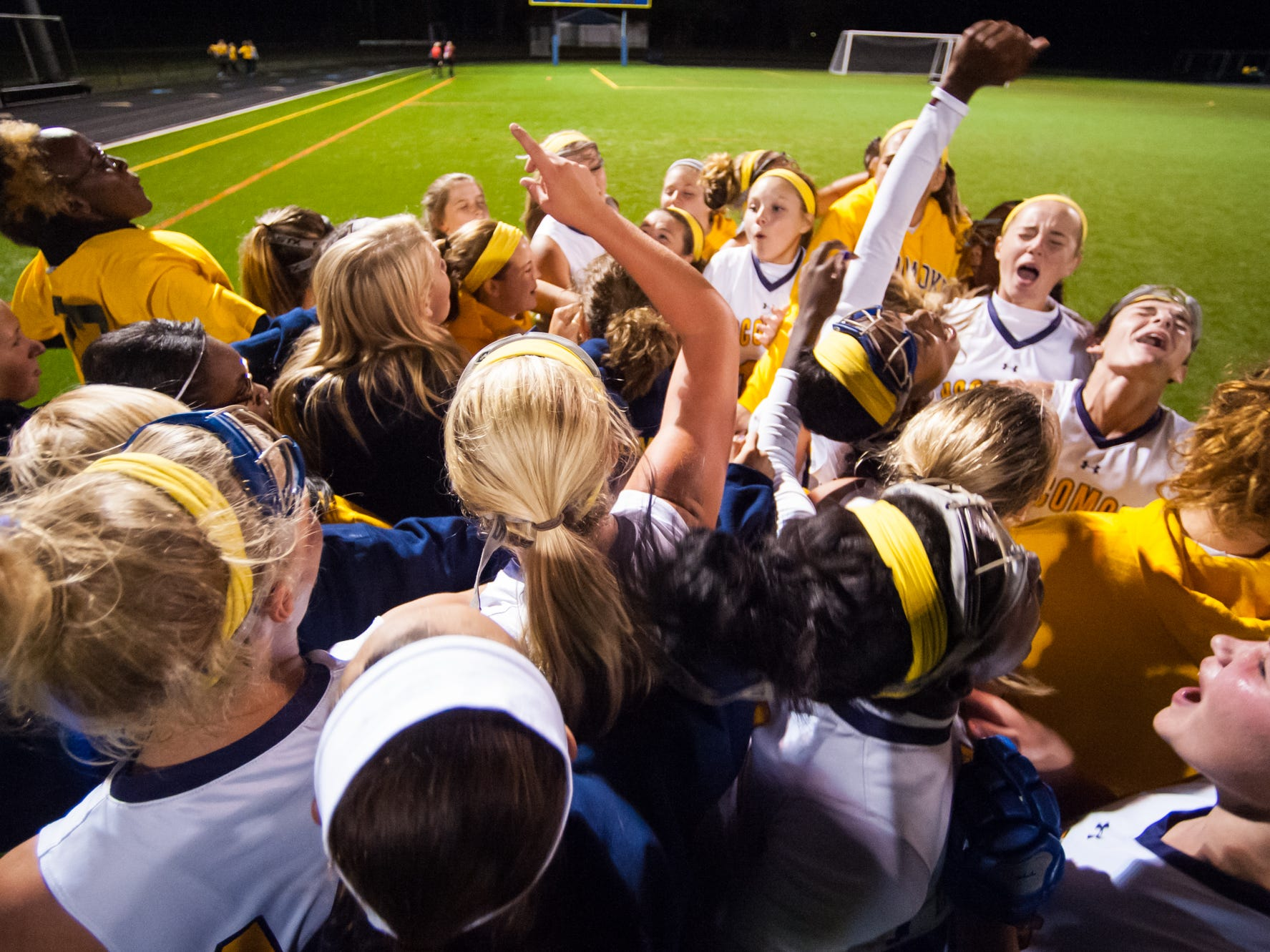 The Pocomoke Warriors celebrate the return of the Bayside field hockey crown to Pocomoke High after a 2-1 victory over Kent Island at Pocomoke High School on Monday night.