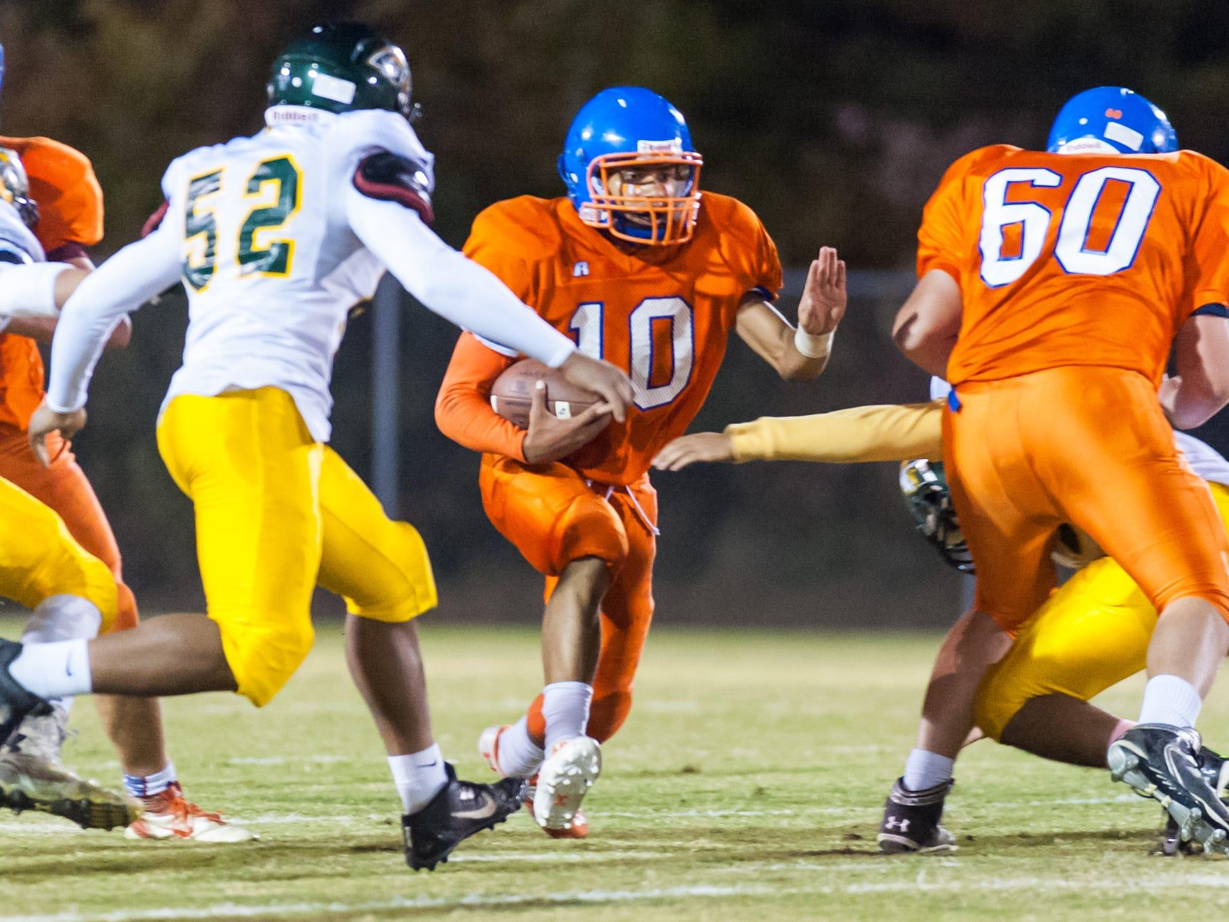 Delmar quarterback Shane Leatherbury (10) hits the hole against Indian River at Delmar High School on Friday evening.