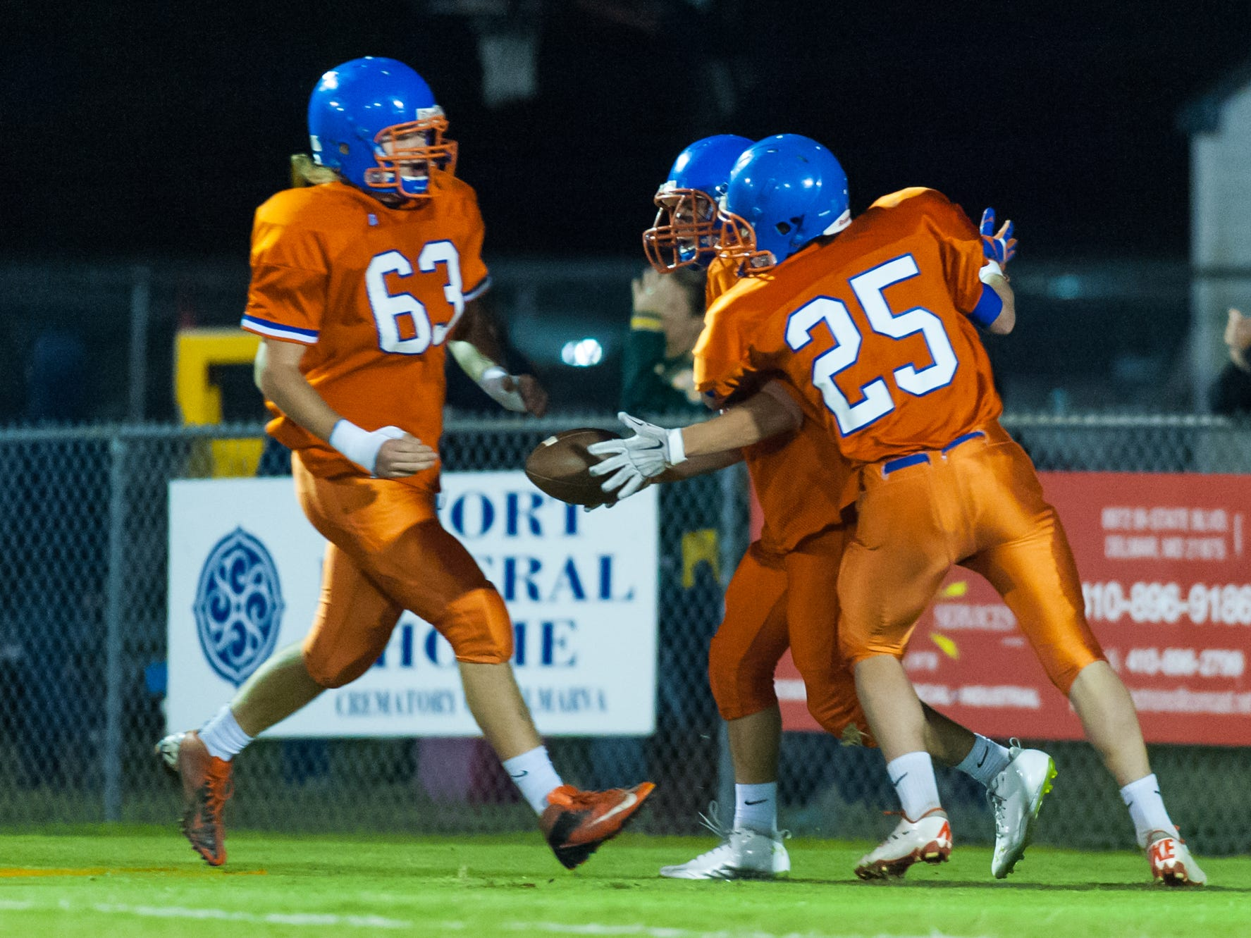 The Delmar defense celebrates a Logan Thomas (36) fumble recovery for a touchdown against Indian River at Delmar High School last Friday.