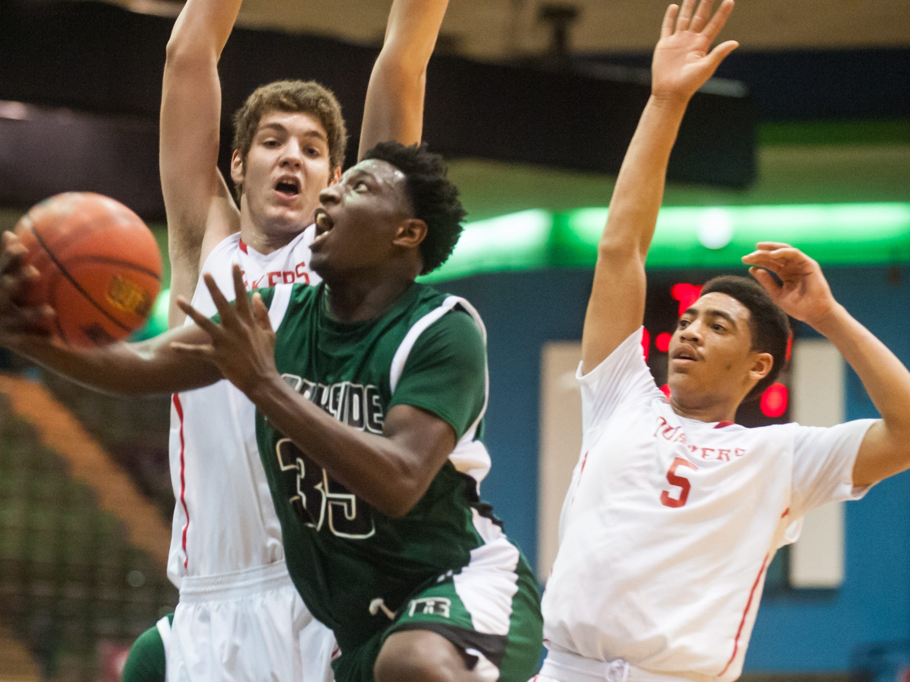 Parkside guard Dajour Diggs (35) drives to the basket against Friends School of Baltimore as part of the DMVelite Showcase during the Governor's Challenge at the Wicomico County Youth and Civic Center on Saturday evening.
