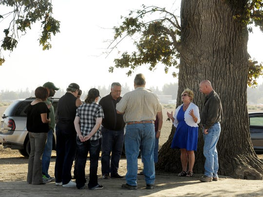 Dennis Sutherland, lead Pastor at Bethel Family Worship Center in Tulare, and a group of parishioners pray for a solution to their problem and for the Tulare City Council to make the right decisions, south of Cartmill Avenue and north of the Tulare Outlet Center, along Retherford Street.