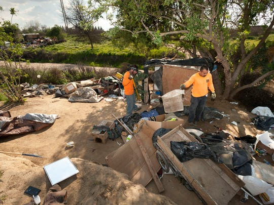 Crews work to clear homeless encampments and the surrounding debris along both sides of the St. Johns River east of Highway 63 on Tuesday, March 3.