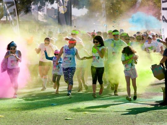 Visalia Color Vibe 5K run started and ended at Rawhide Baseball Park on Saturday, April 4, 2015.