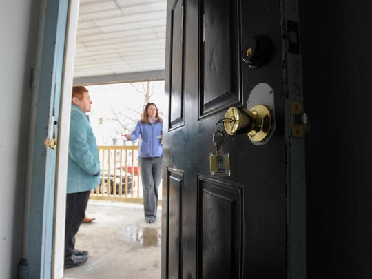 Jeanine Kleimo (left), of Dover Interfaith Mission for Housing and Jocelyn Tice, executive director with Central Delaware Habitat for Humanity, tour a home on South Queen Street in downtown Dover on March 3. In the past year, the state capital has seen an influx of grant money and commercial opportunity. City officials and residents hope there are bright days ahead. But there also are concerns the neighborhoods that need the most help won't get it.
