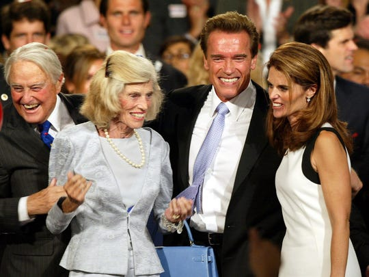 Eunice Kennedy Shriver, sister of former President John F. Kennedy, founded the Special Olympics. In this photo from 2003, Shriver is seen celebrating with her daughter, Maria Shriver, right, and her husband, Arnold Schwarzenegger, then governor of California.