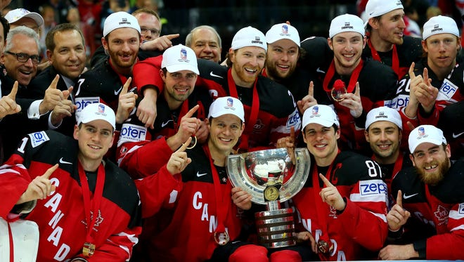 The team of Canada celebrate with the trophy after winning against Russia during the IIHF World Championship gold medal match between Canada and Russia at O2 Arena.