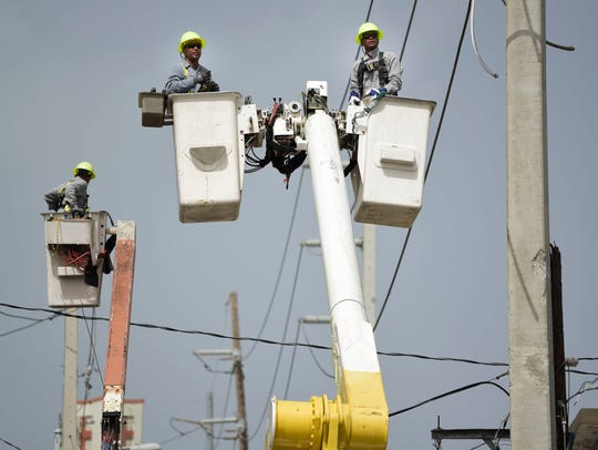 A brigade from the Electric Power Authority repairs