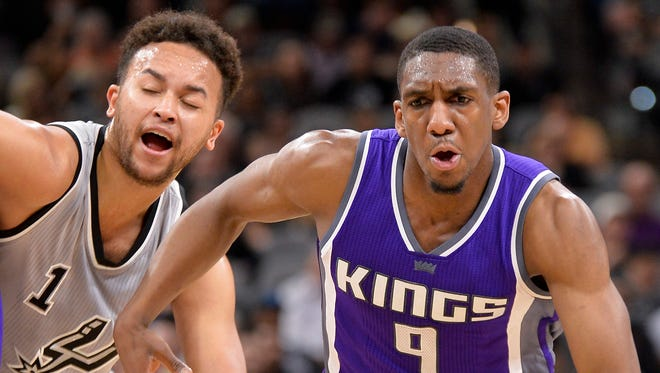 Kings guard Langston Galloway drives around Spurs forward Kyle Anderson on March 19, 2017 in San Antonio.