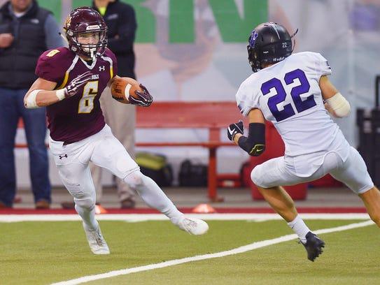 Madison's Jaxon Janke runs the ball down the field