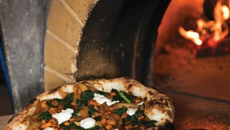 Wood-fired pizzas coming out of the oven at Dough Artisan Pizzeria in Caldwell. They specialize in locally-sourced, fresh ingredients used in their pizzas, Italian dishes and popular Heritage chicken. For the Dining Out section of Montclair Magazine, Spring 2016 issue. ANNE-MARIE CARUSO/STAFF PHOTOGRAPHER