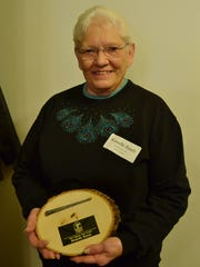 Romelle Rusch received the Manitowoc County Historical Society's Square Nail Volunteer Service Award.