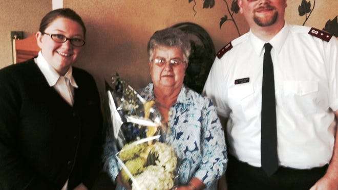 """The 2014 Brown Bag Lunch wrap up celebration was hosted by Salvation Army Captains Telinda Wilson, left, and Steven Wilson, right, at the Backyard Grill & Bar in Fond du Lac. Barb Thill, center, was honored by Botanicals Floral and Sunny 97-7 as a """"FDL Distinctly Different Citizen"""" for her eight years of leadership of the Brown Bag program. Thill and volunteers packed over five tons of food into 13,000 lunches and distributed them at four locations during the course of the 2014 summer season."""
