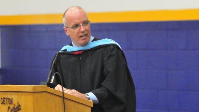Principal Rick Ruhl addresses Seton Catholic's graduates Sunday.