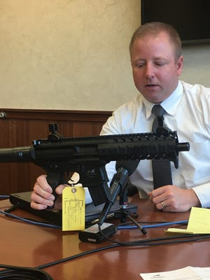 Minnehaha County Sheriff's Office Capt. Jason Gearman explains how two men used stolen credit cards to purchase a pellet gun, which looks eerily similar to the real deal. April 11, 2017.