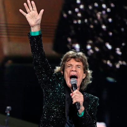Mick Jagger gestures as The Rolling Stones play at