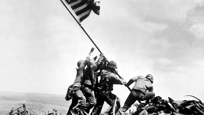 Flag raising on Iwo Jima.  February 23, 1945.