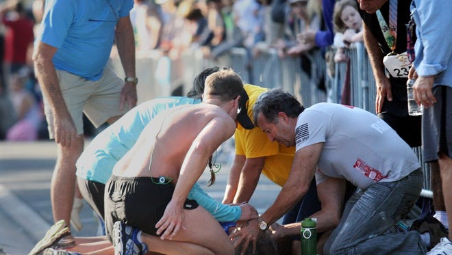 Greg Wolpert, 59, of Naples, is given CPR after collapsing during the Naples Half Marathon on Sunday. Wolpert was later treated and released from Naples Community Hospital.