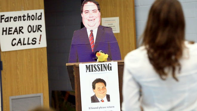 Lander Baiamonte asks a question to a cutout of U.S. Rep. Blake Farenthold during a town hall meeting Wednesday, April 19, 2017, at the Oveal Williams Senior Center in Corpus Christi.