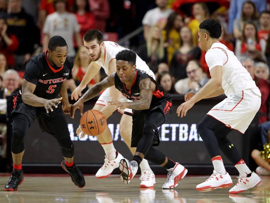 Rutgers guard Mike Williams, Maryland forward Ivan Bender, Rutgers guard Nigel Johnson and Maryland guard Jaylen Brantley, from left, chase a loose ball during the first half of an NCAA college basketball game, Tuesday, Jan. 24, 2017, in College Park, Md. (AP Photo/Patrick Semansky)