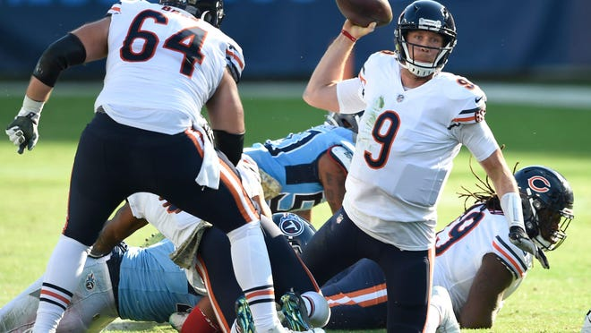 Chicago Bears quarterback Nick Foles (9) throws as he is pressured on a play in which the Tennessee Titans were penalized for offsides during the third quarter at Nissan Stadium Sunday, Nov. 8, 2020 in Nashville, Tenn.