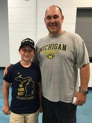 Robert Garcia and his son Sean, of Ann Arbor, were