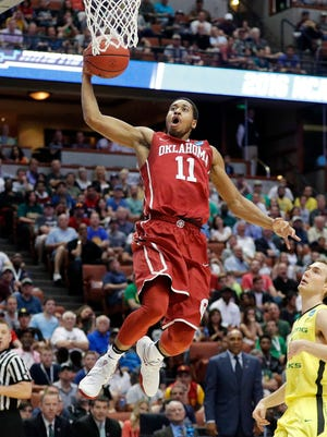 Oklahoma guard Isaiah Cousins drives to the basket during a game against Oregon in the regional finals of the NCAA Tournament on March 26 in Anaheim, Calif.