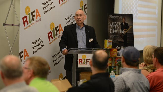 Regional Inter-Faith Association Board President Dan Brooks spoke during RIFA's media luncehon for the 2015 Canstruction event.