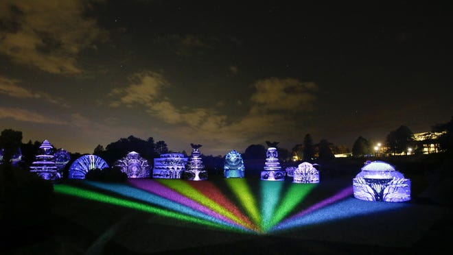 The Topiary Garden becomes a colorful soundstage during 'Nightscape — A Light and Sound Experience' at Longwood Gardens. The installation runs through Oct. 31 with limited tickets available.