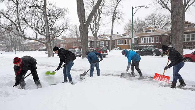 Volunteers shovel sidewalks in the 7700 block of South Wabash Avenue in Chicago's Chatham neighborhood on Saturday, Jan. 19, 2019. Organized by My Block, My Hood, My City, more than 50 people gathered to clear snow from sidewalks and front steps throughout the South Side. (John J. Kim/Chicago Tribune/TNS)