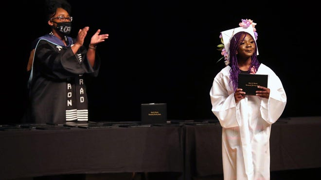 After an asthma attack in November 2012 led to severe brain injury, doctors believed D'Ayshunah Kind would never walk again. On Monday, Kind was one of many seniors that walked across the stage in a socially distant graduation ceremony held at John R. Buchtel Community Learning Center in Akron.