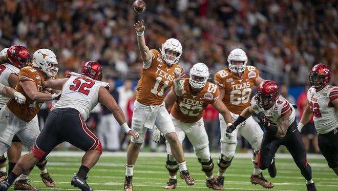 Texas quarterback Sam Ehlinger passes the ball during the Alamo Bowl last December in San Antonio. The Longhorns are beginning preparations for the 2020 season amid coronavirus concerns.