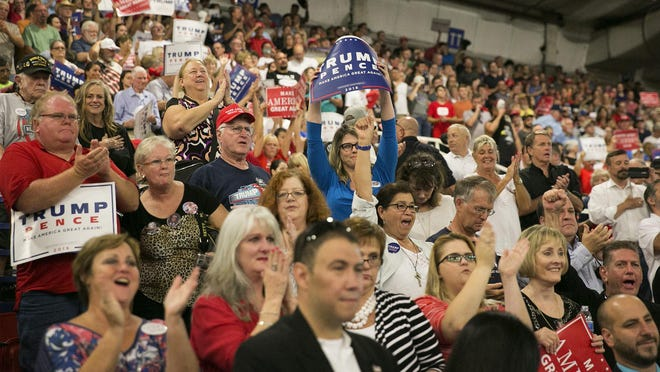 Donald Trump supporters cheer after the national anthem at a rally at the Travis County Exposition Center in 2016.