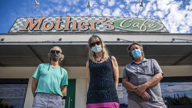 Mother's Cafe owners John Silberberg, from left, Anne Daniels and Cameron Alexander prepare to say goodbye to the restaurant they've called home for 40 years.