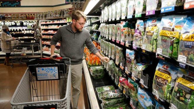 Mikel Livingston shops for groceries for the SNAP Challenge at Pay Less Super Market on Beck Lane. Livingston tried to live on $29.69, the average amount of benefits food stamp recipients receive each week.