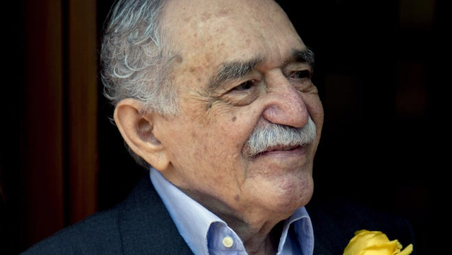 Colombian Nobel Literature laureate Gabriel Garcia Marquez greets fans and reporters outside his home on his 87th birthday in Mexico City. Marquez died Thursday April 17, 2014 at his home in Mexico City.