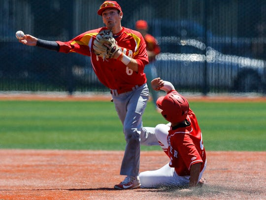 Palma's Anthony DeSantis turns a double play against San Benito.