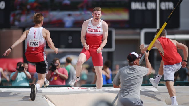 University of South Dakota's Chris Nilsen celebrates after he clears 19-2.75 feet at the Dakota Relays Saturday, May 5, at Howard Wood Field in Sioux Falls.