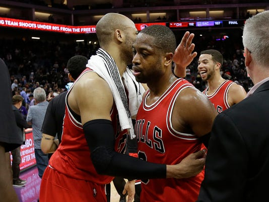 Chicago Bulls guard Dwyane Wade, right, is congratulated by teammate Chicago Bulls forward Taj Gibson after the Bulls beat the Sacramento Kings 112-107 in an NBA basketball game Monday, Feb. 6, 2017, in Sacramento, Calif. (AP Photo/Rich Pedroncelli)