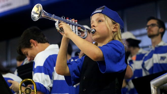 Eli Deml warms up his toy trumpet with the MTSU Pep Band before the MTSU vs. Florida Atlantic game on Saturday, March 4, 2017.